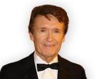 Dr Gerald James